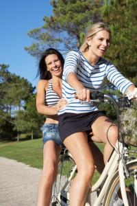 Two Women Enjoying Cycle Ride